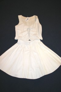 white leather corset vest and gored skirt